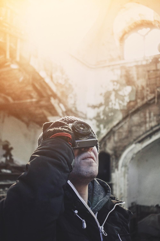 person holding camera looking upward