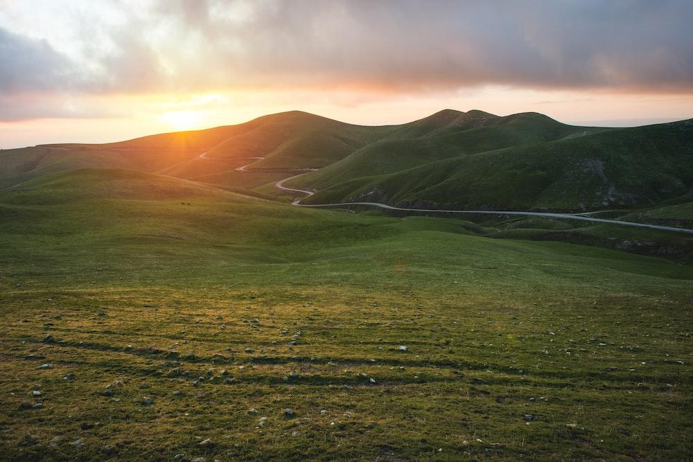 green mountain during sunset