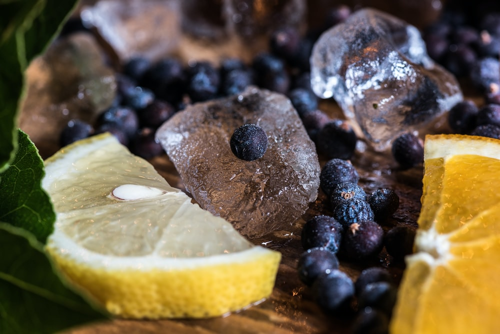 berries and sliced lemons with ice cubes