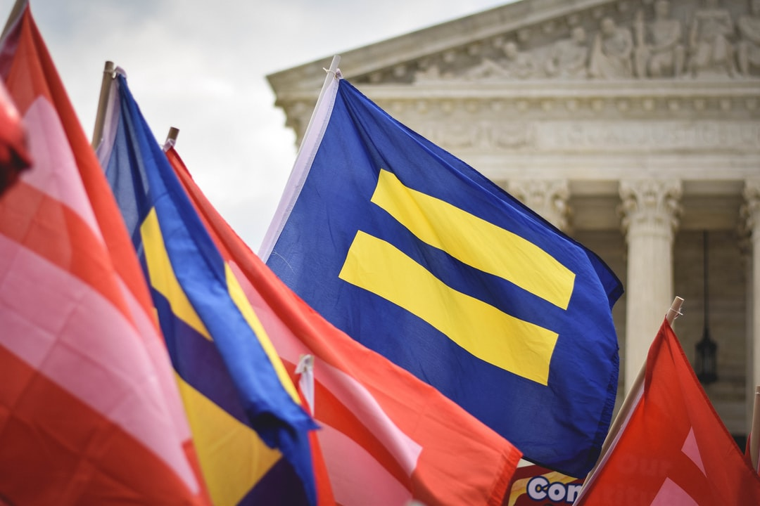 Pro-LGBT equality protesters were waving this flag outside the United States Supreme Court, on Washington, D.C.'s Capitol Hill, on the morning of June 26, 2015. Minutes later, a group of media pages sprinted across the marble plaza, and cries of joy broke out from the crowd as reporters breathlessly announced the Court's decision in the landmark case Obergefell v. Hodges: same-sex marriage had been ruled a fundamental constitutional right in all 50 states.
