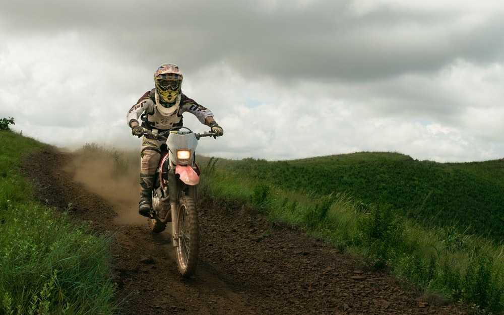 rule of thirds photography of white dirt bike