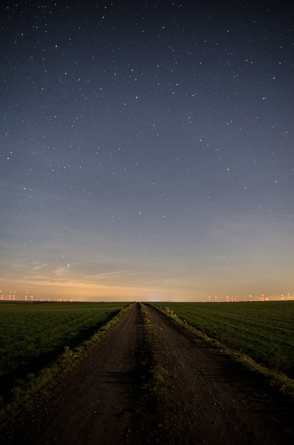 green grass field under blue sky during night time