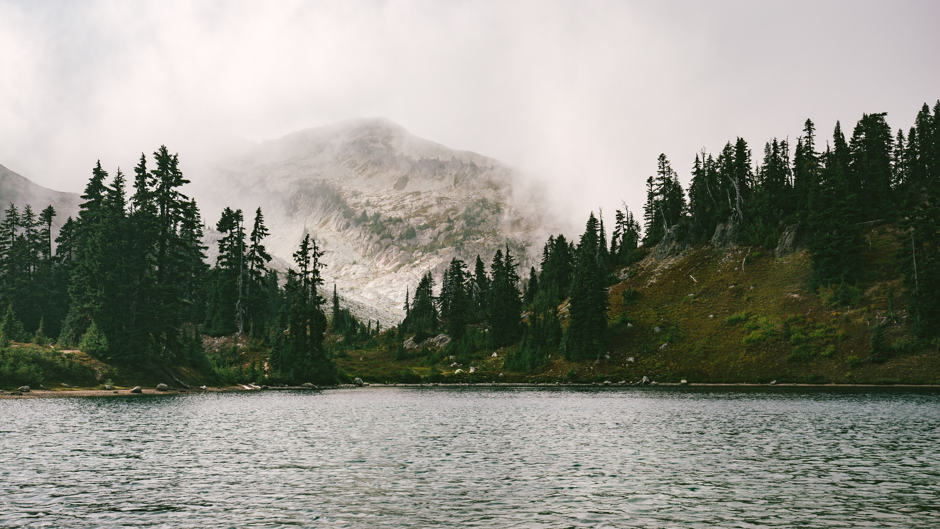 A foggy mountain near a lake in North Cascades National Park