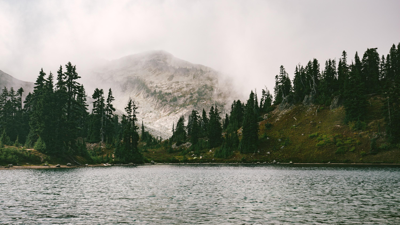 A foggy mountain near a lake in North Cascades National Park