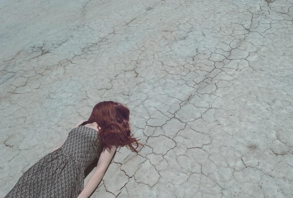 woman lying on ground