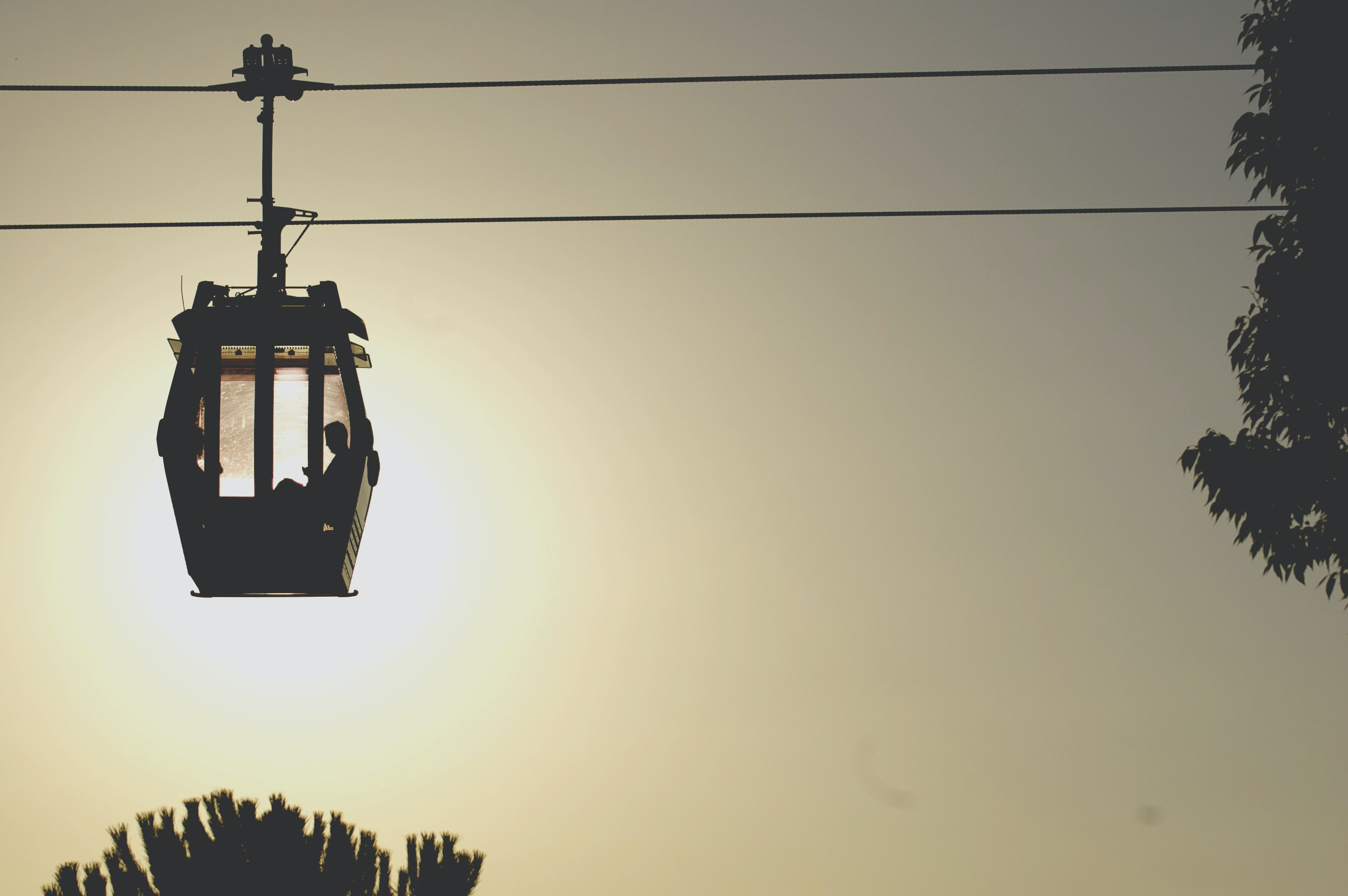 Side view of a cable car silhouette.