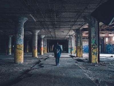man walking hallway during daytime urban zoom background