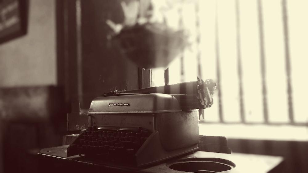 grayscale photo of Remington typewriter