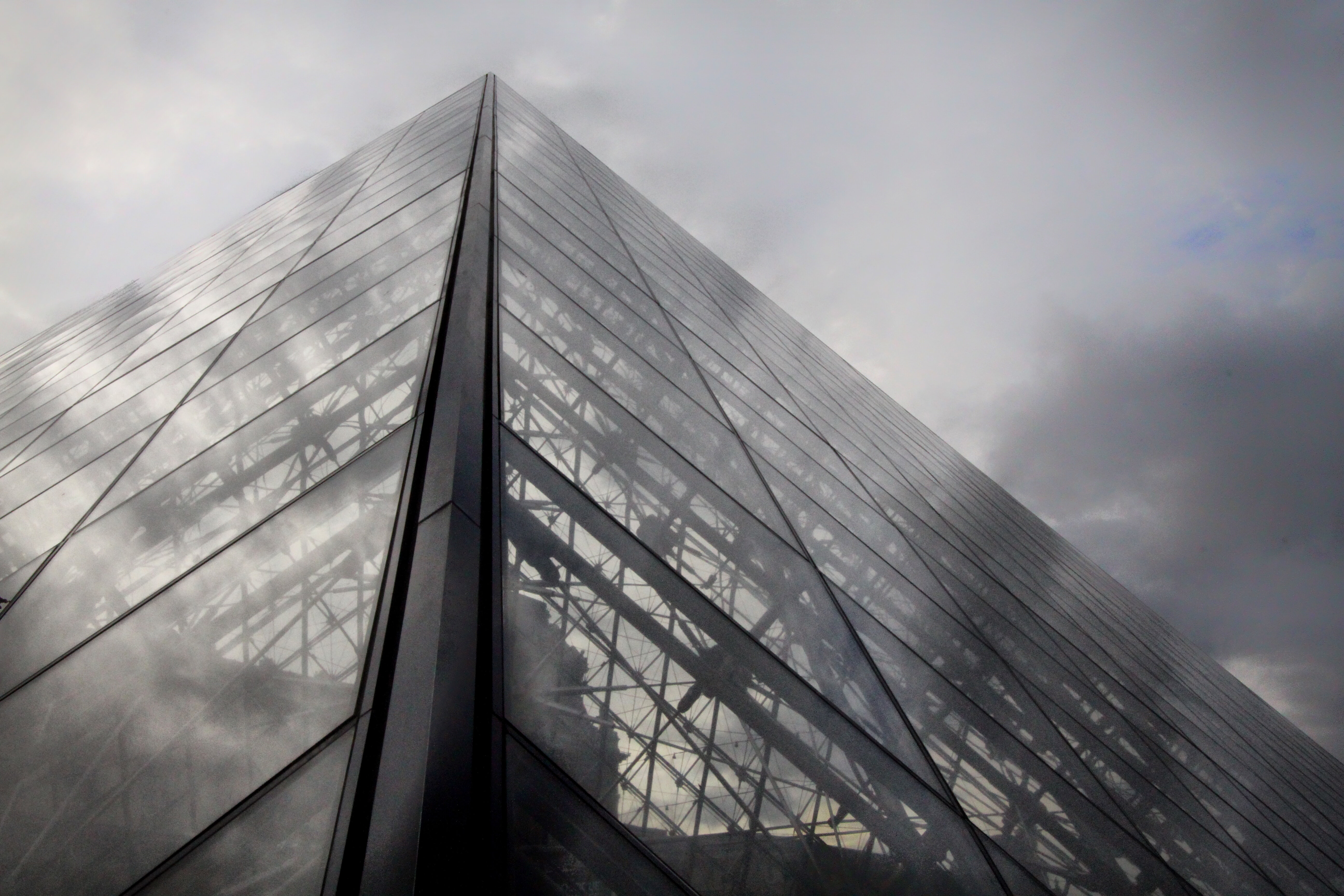 The glass wall exterior of a large French building.
