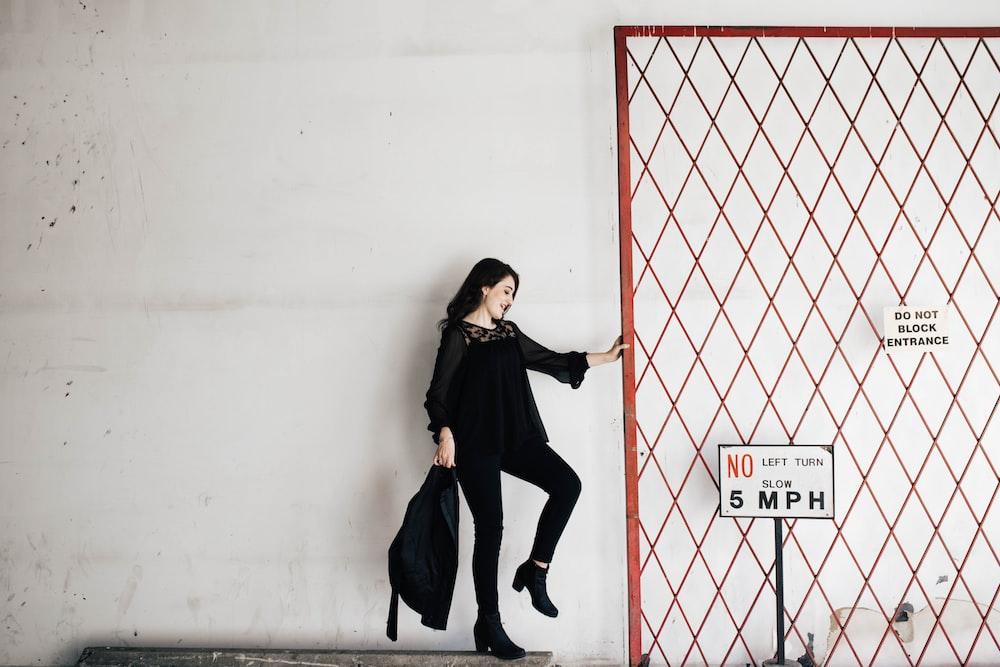 woman carrying black bag