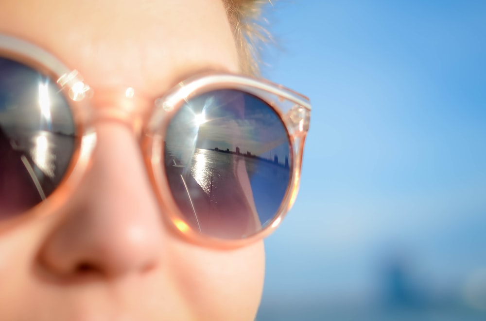 woman wearing brown framed sunglasses