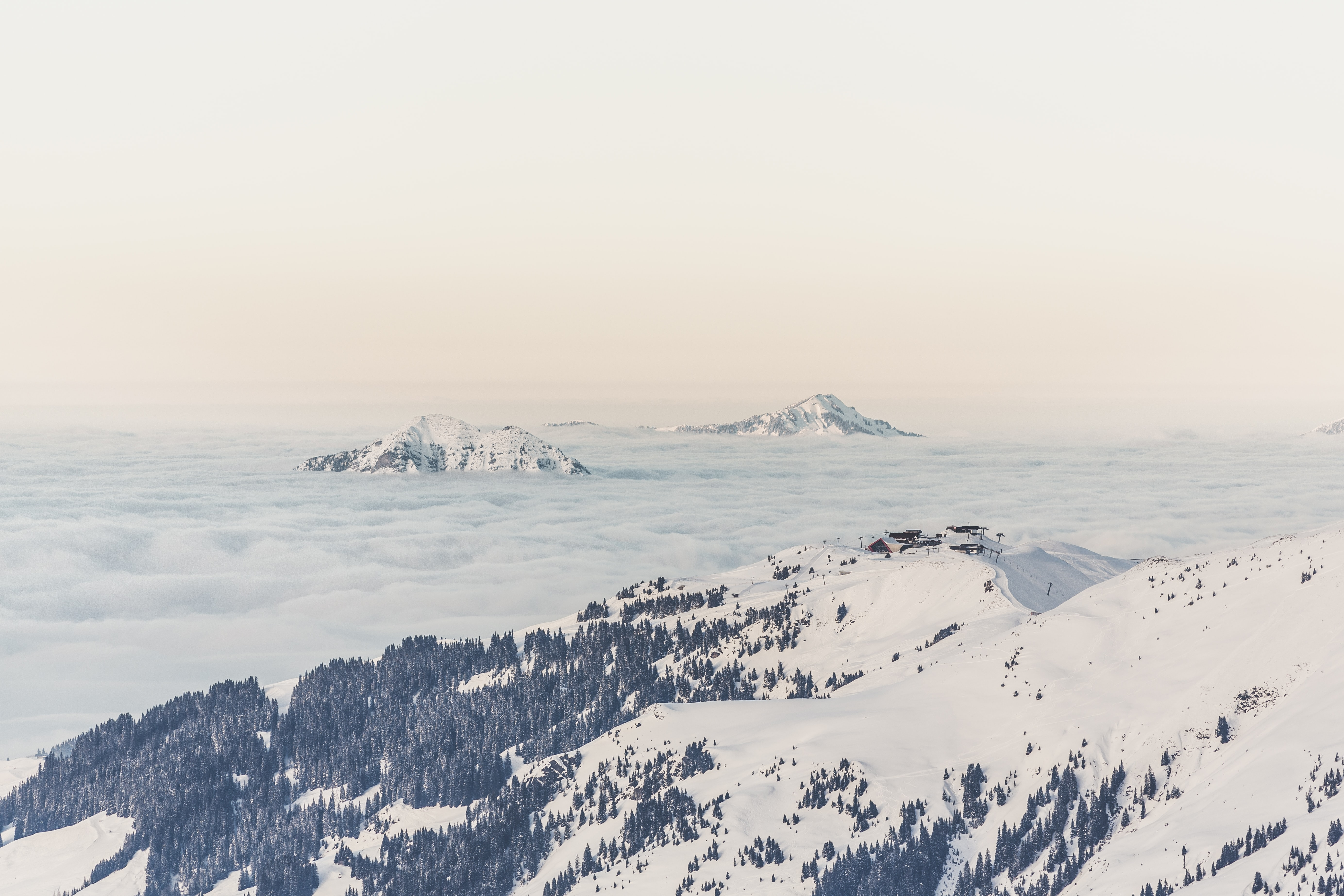 View of Snowy mountain peaks of the Kitzbühel Alps amongst the clouds from the Hahnenkammbahn cable car