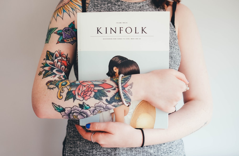 person holding Kinfolk book