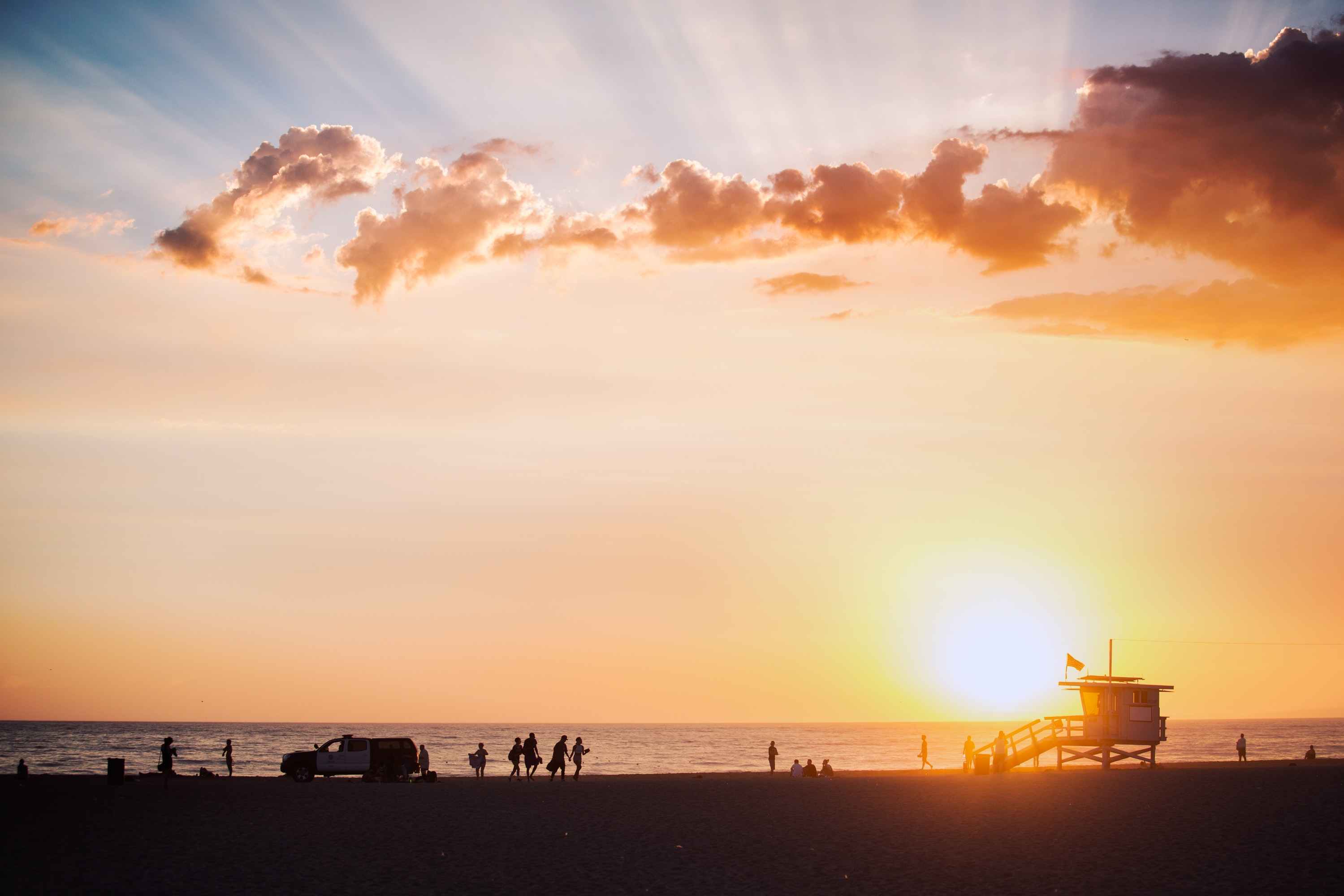 Sunset from a crowded beach at The Venice Beach Boardwalk