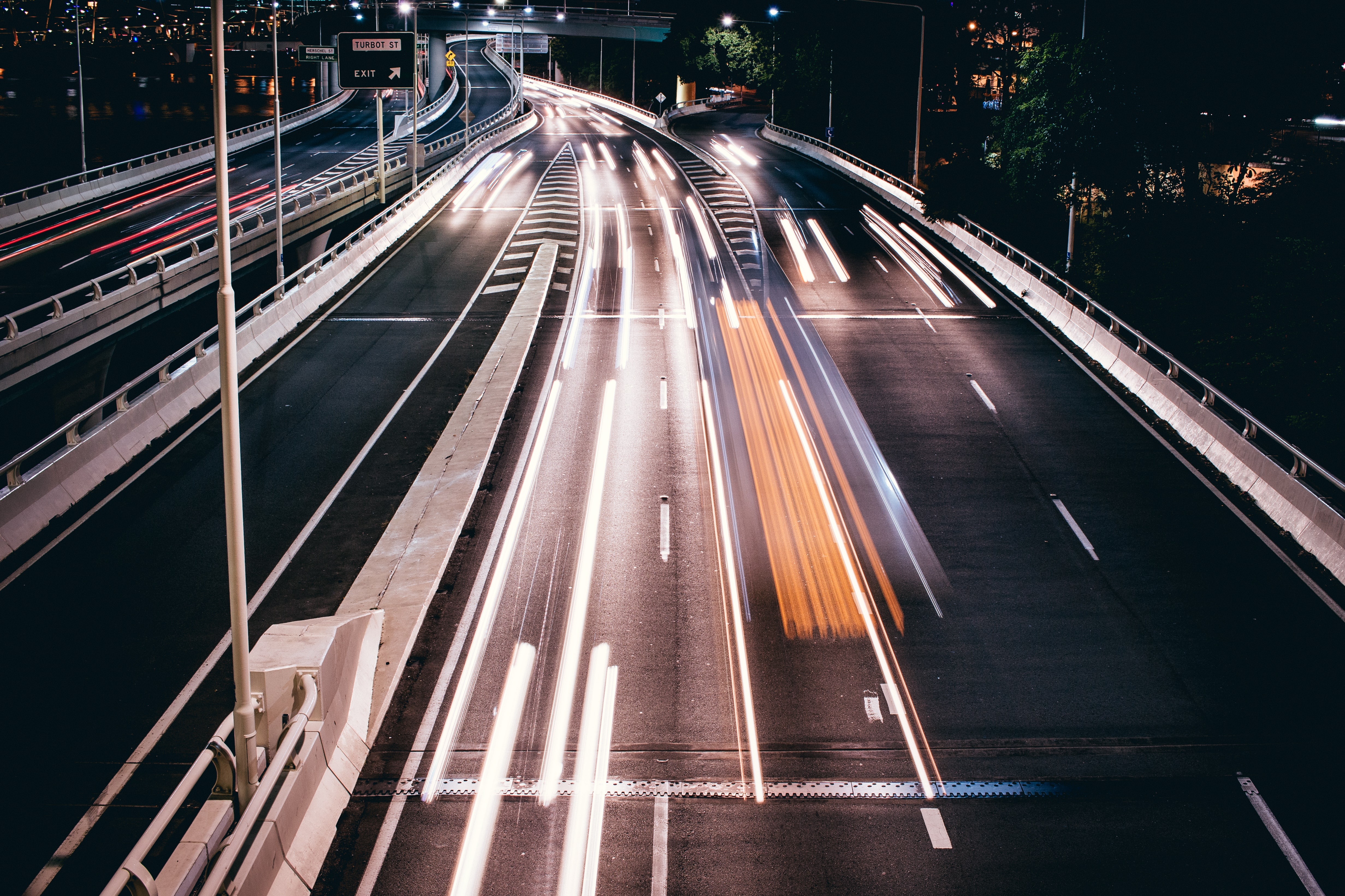 timelapse photography of roads during nighttime