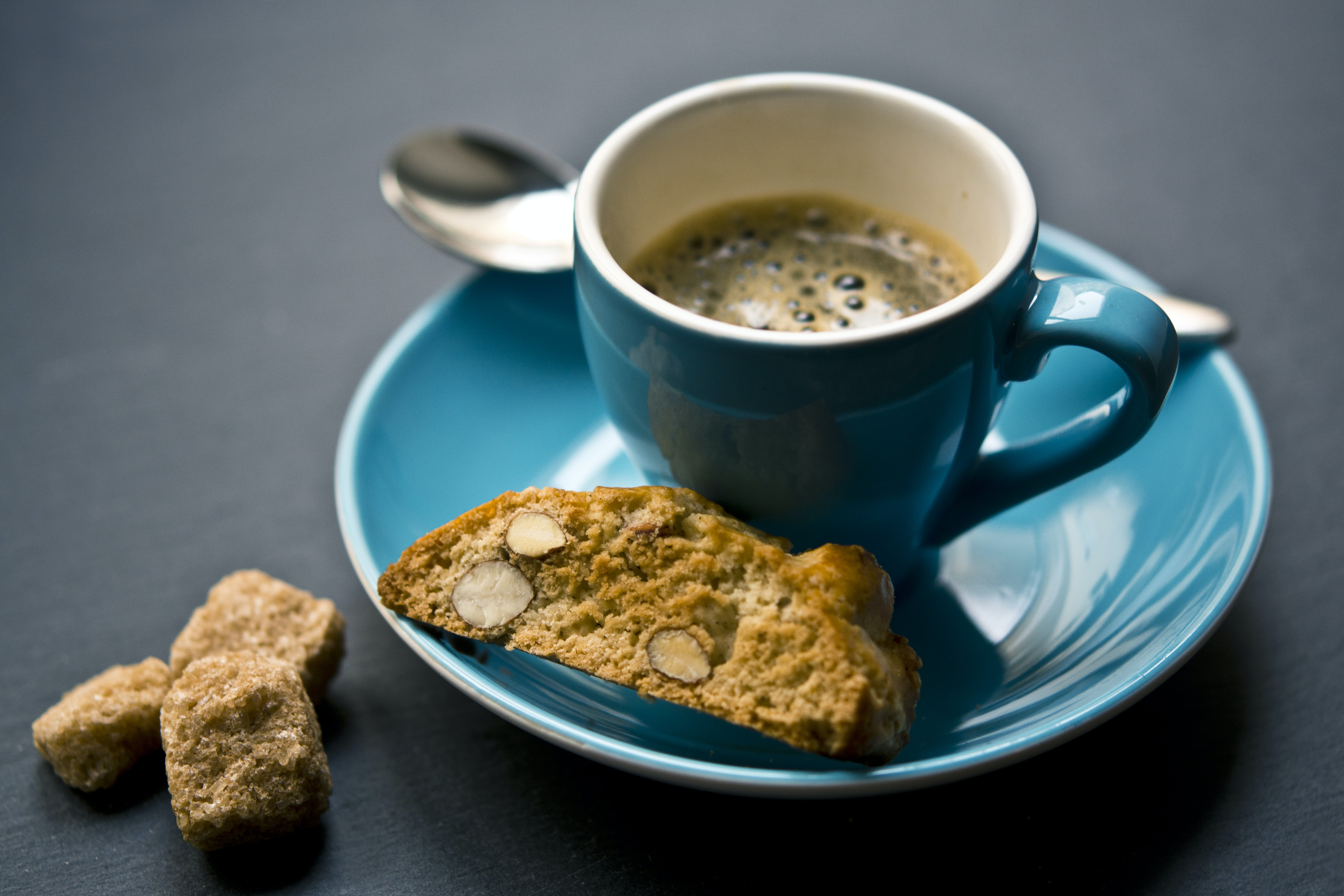 cup of coffee and bread on saucer closeup photography