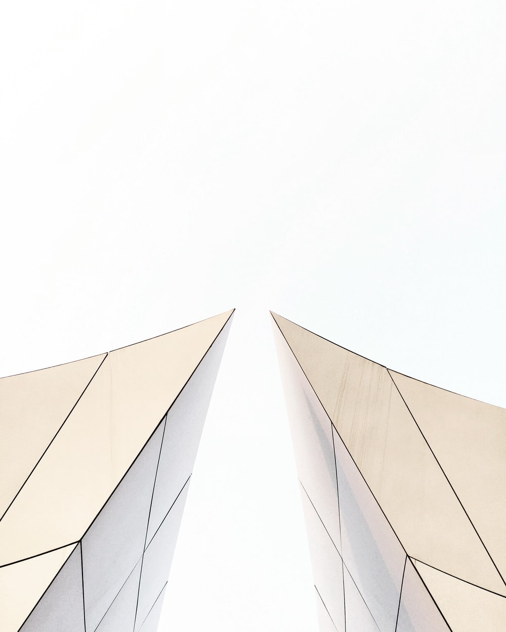 two white buildings about to touch each other's peak