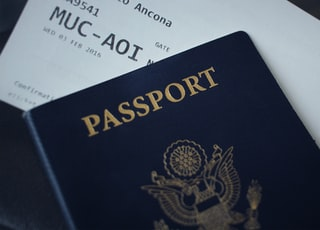 passport booklet on top of white paper