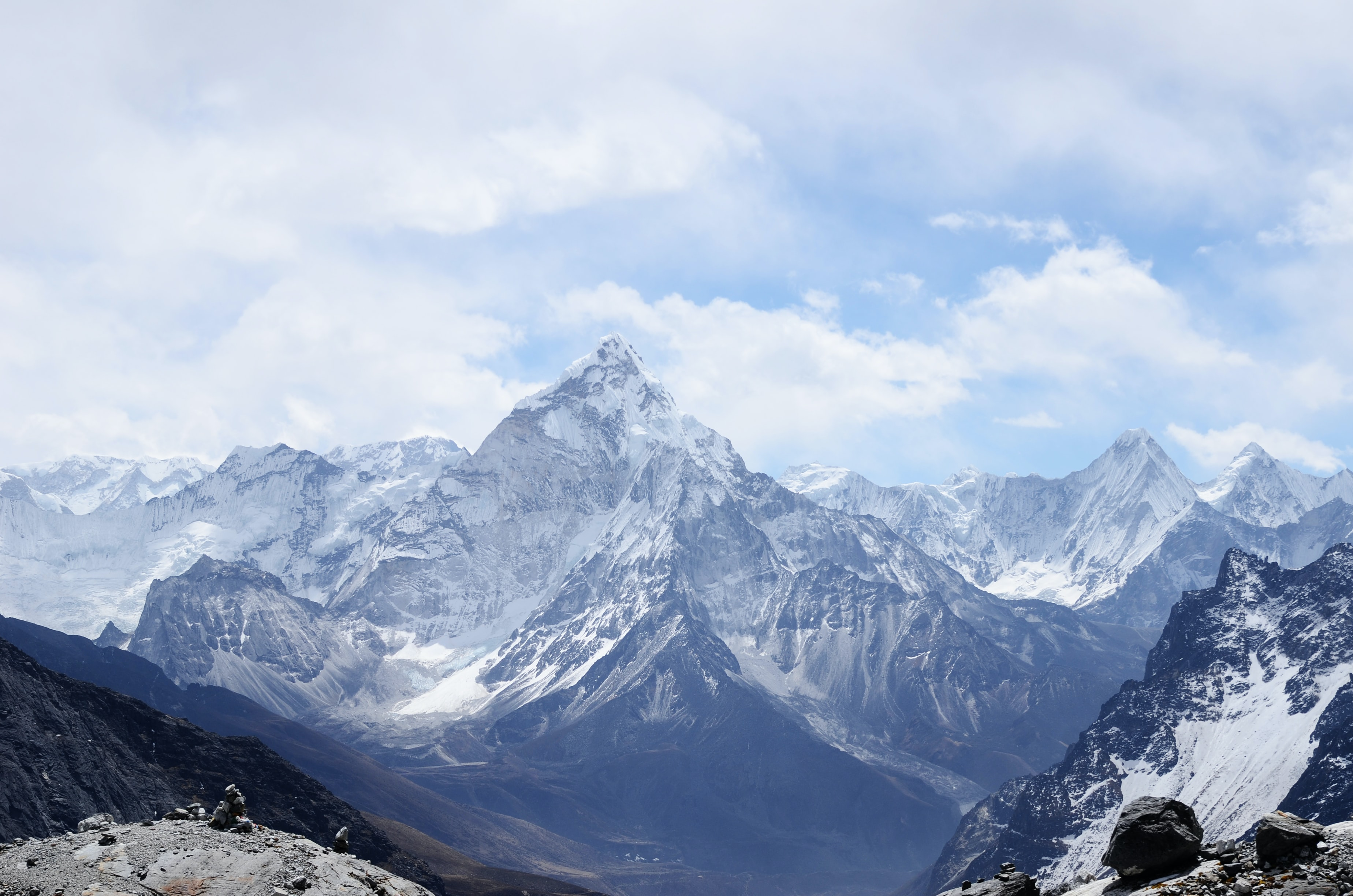 Dramatic landscape with the peak of the mighty Ama Dablam mountain towering over a valley