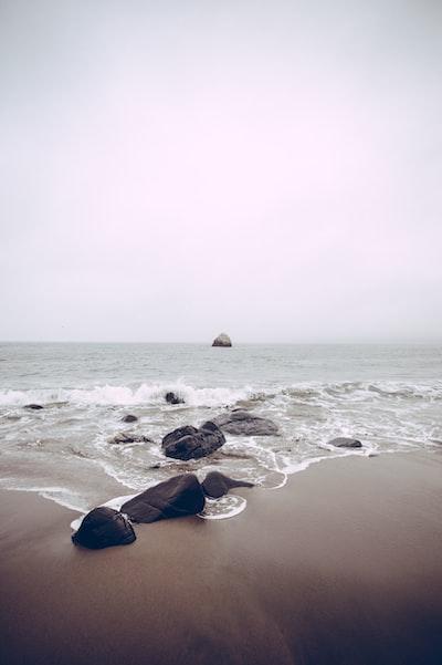 rocks on sea side at daytime
