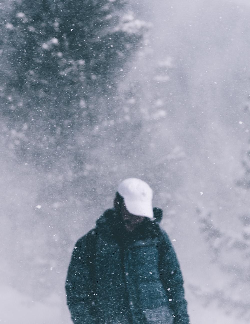 man wearing black snowsuit during winter