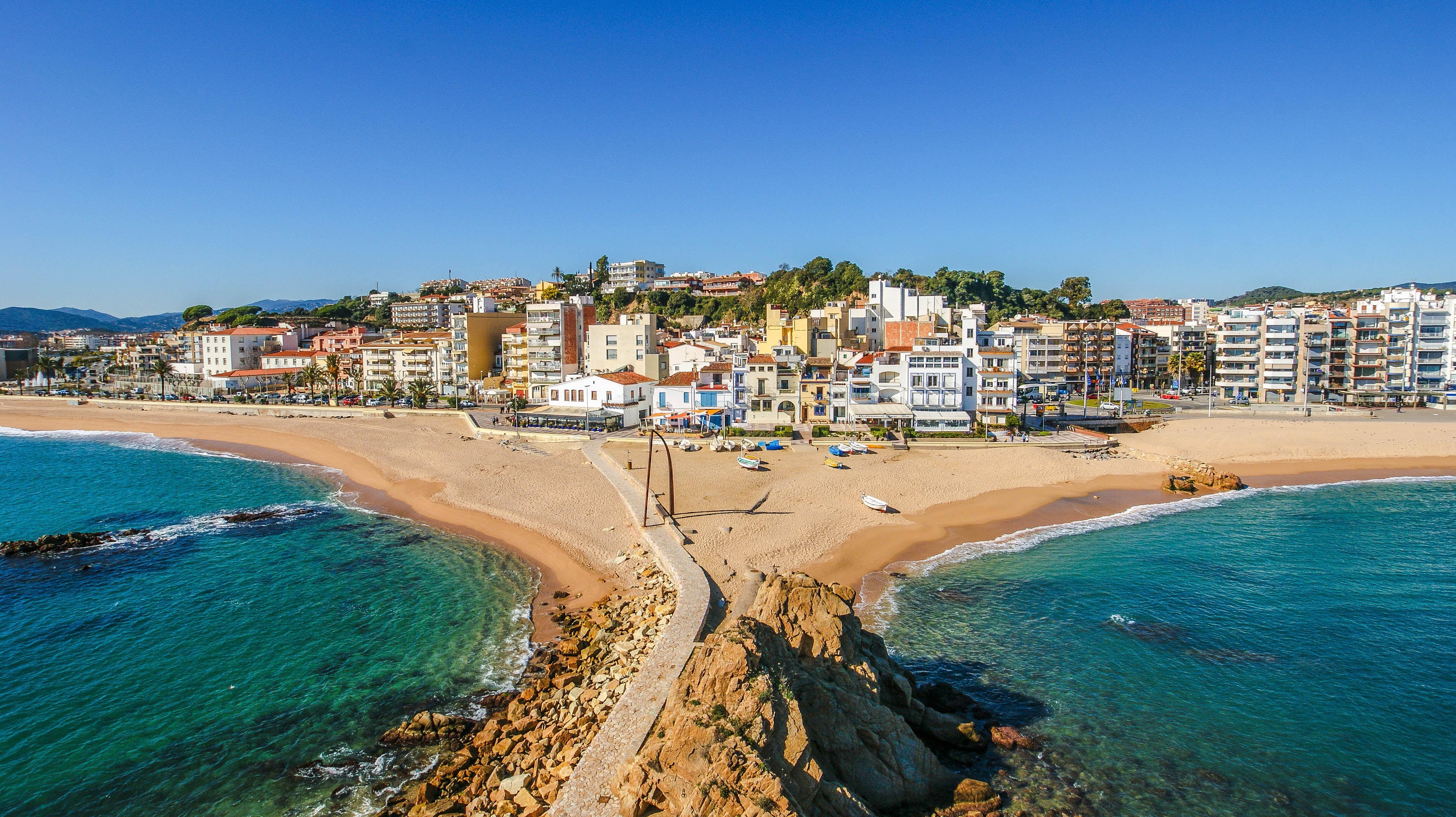 Sa Palomera town on the sand beach shoreline
