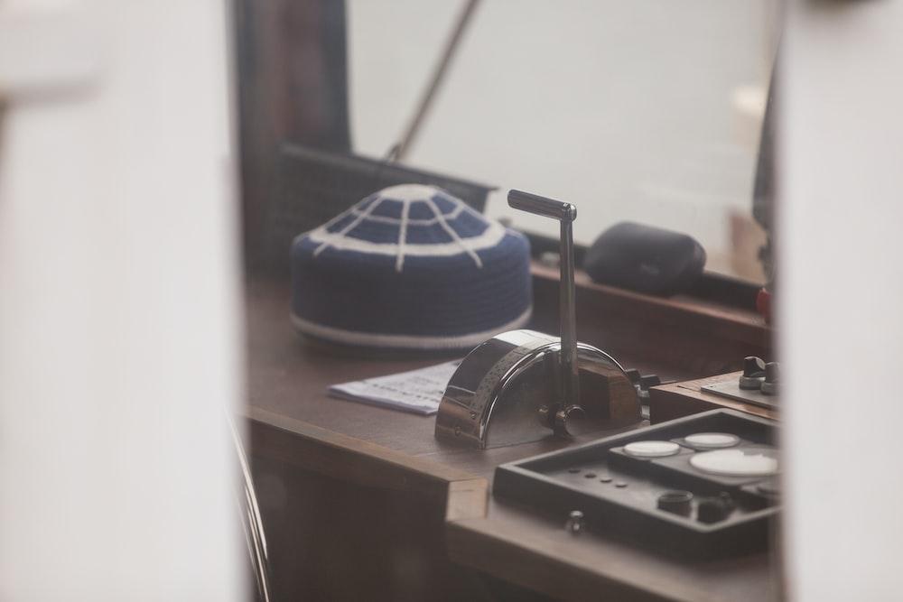 blue cushion on brown wooden desk