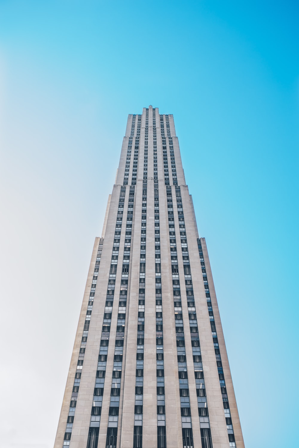 low-angle photo of gray concrete building