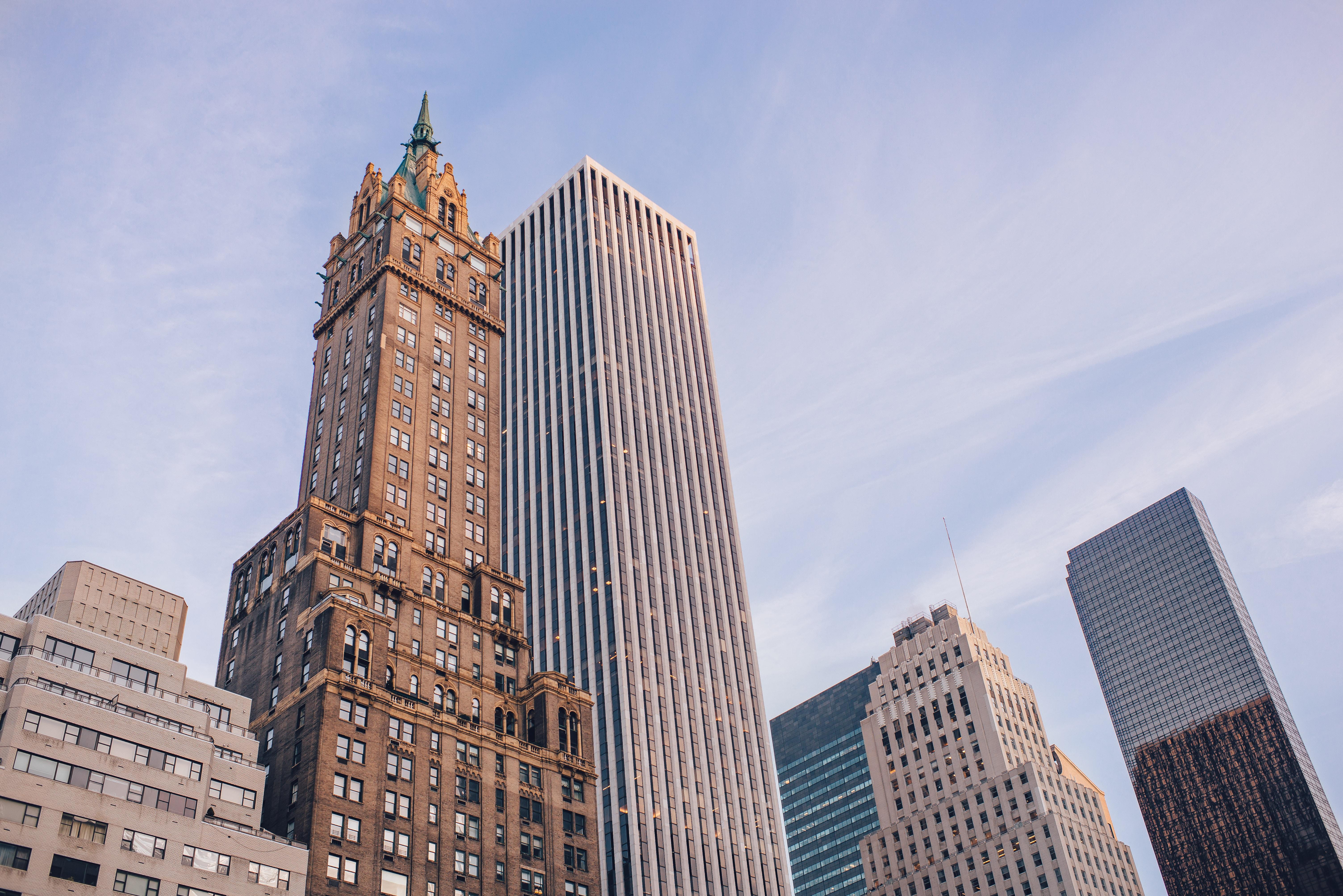 high-rise concrete buildings under blue sky
