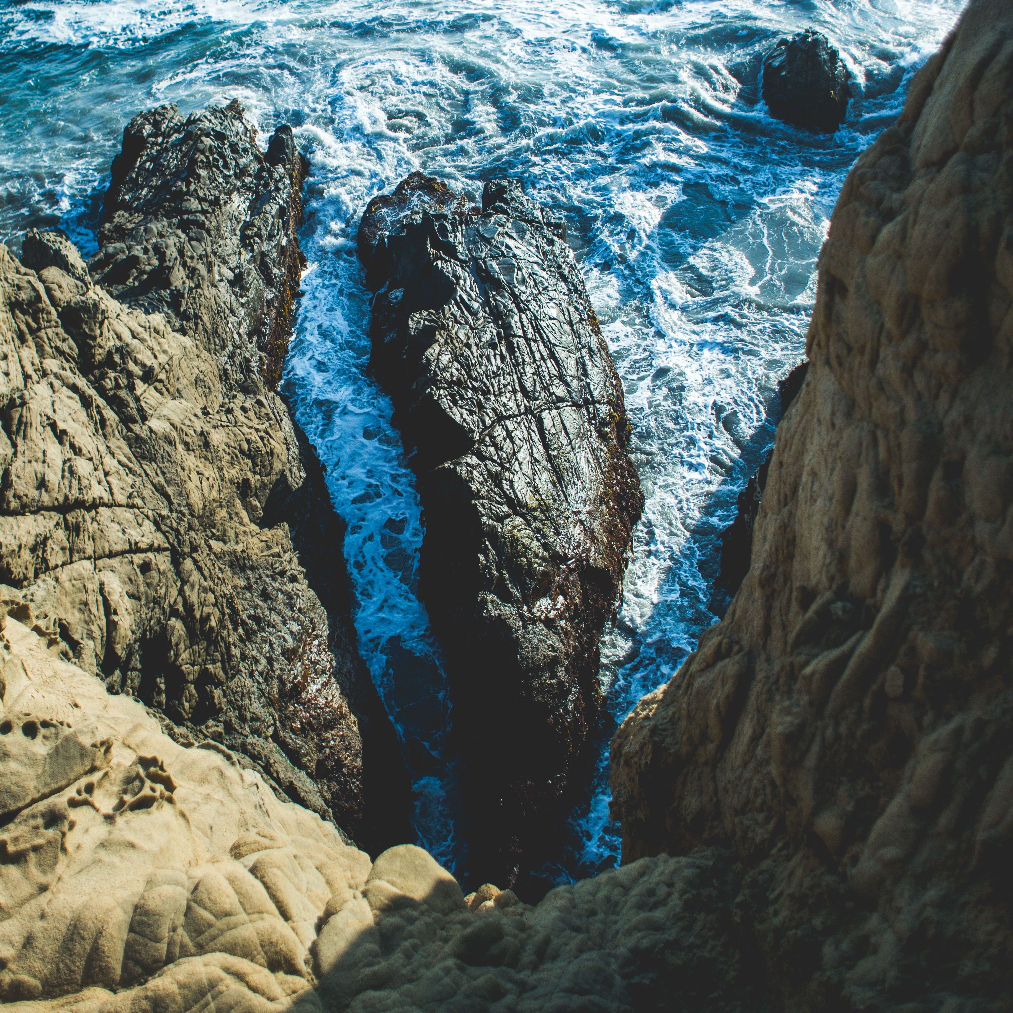 Ocean rocks viewed from a coastline cliff at Pfeiffer State Beach