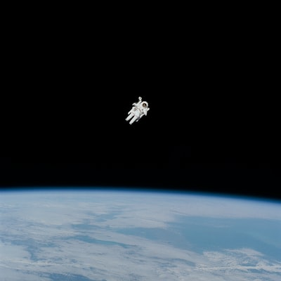 astronaut in spacesuit floating in