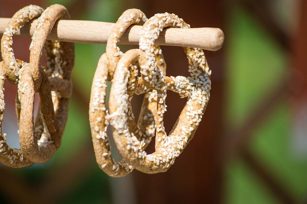 focus photo of four brown pretzels