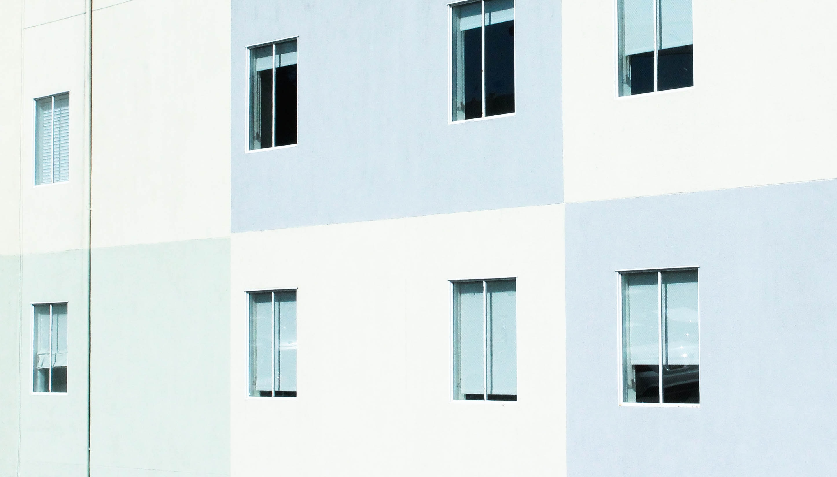 A residential building facade in San Francisco painted in gray and white rectangles