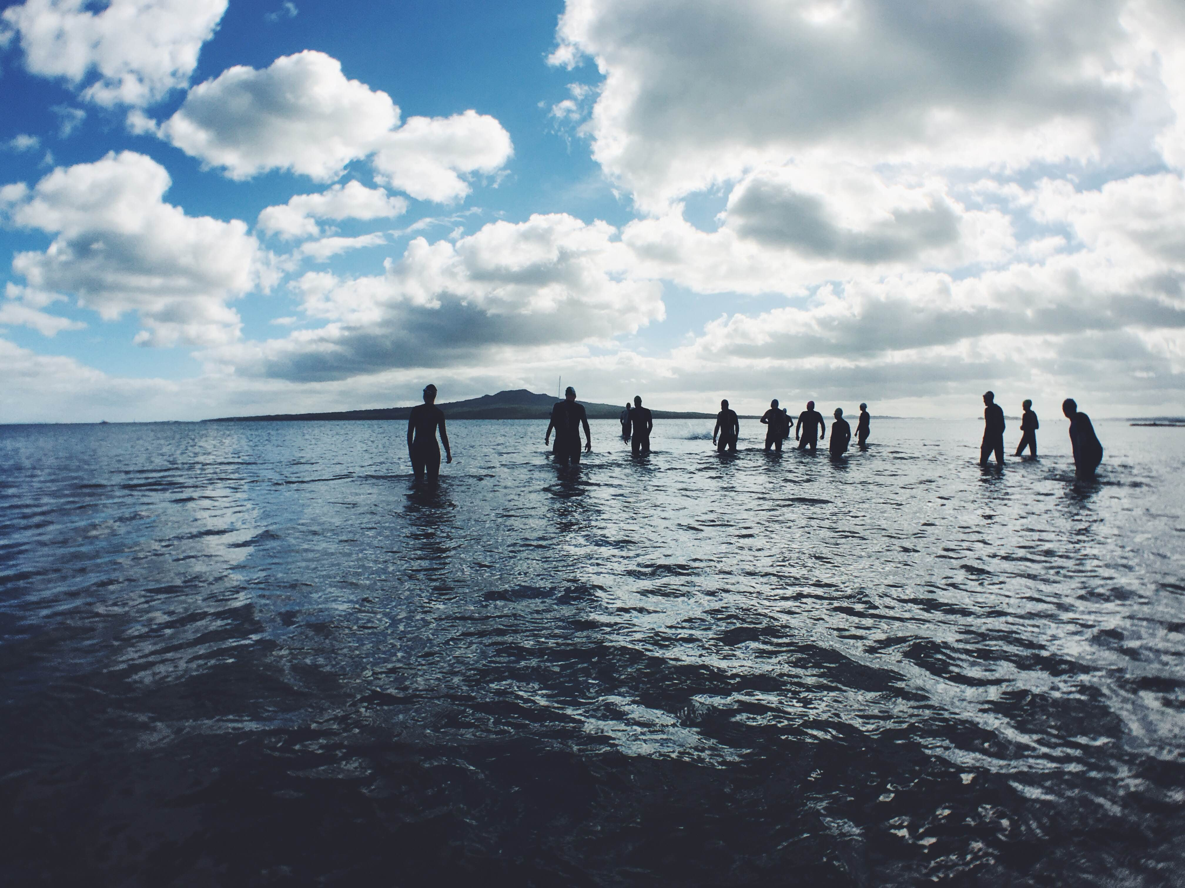 Group of people in the waist deep ocean at Narrow Neck Beach