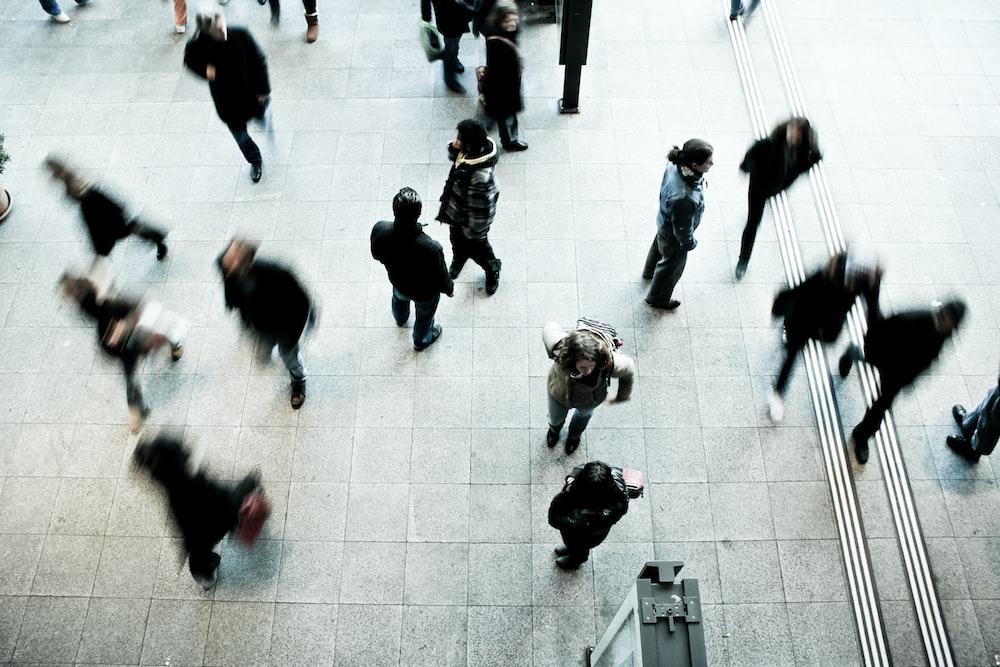 people walking on grey concrete floor during daytime