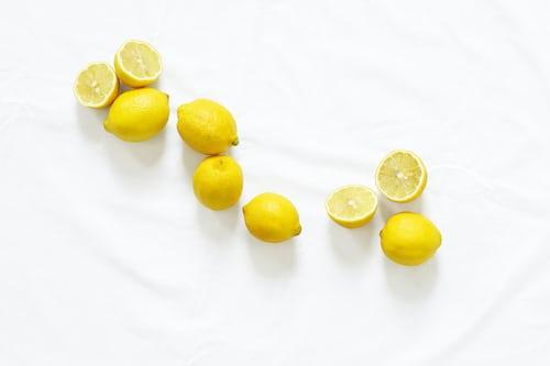 Bunch of sliced lemons on white background