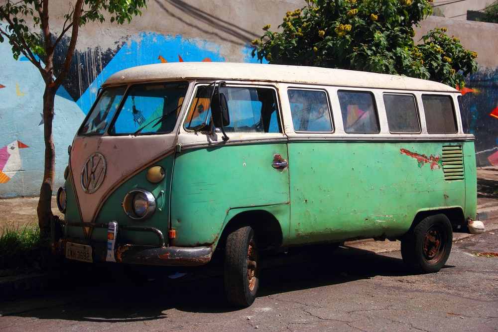 green and white Volkswagen T2