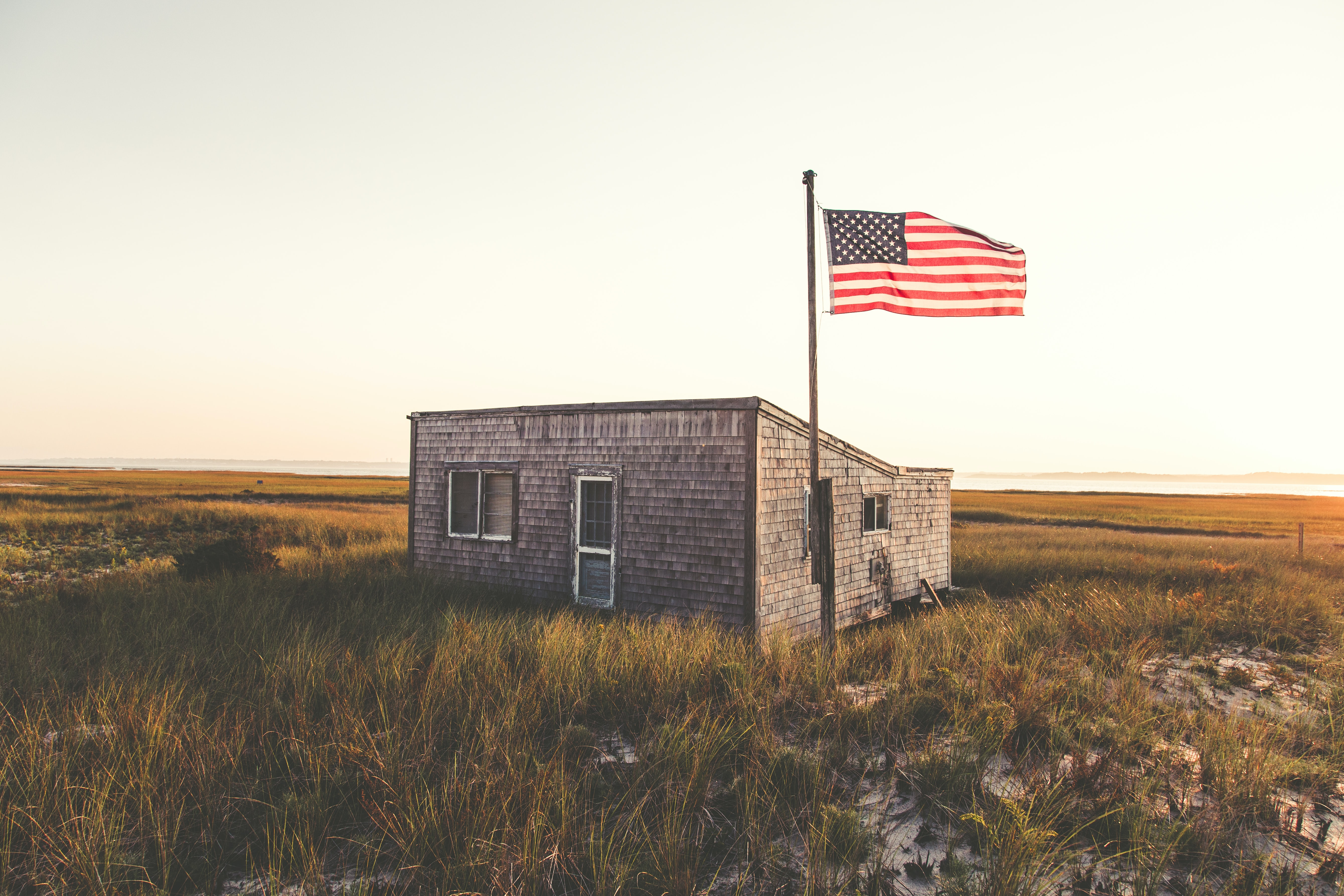 Small building with an American flag at Chatham beach