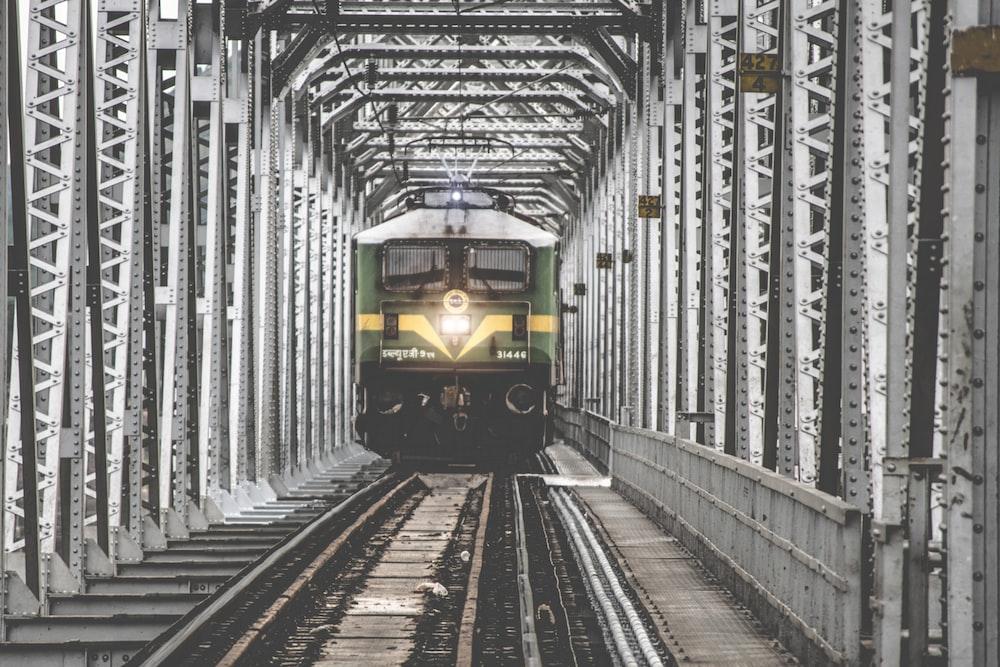 green train on railroad