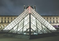 Glass Louvre pyramid at night