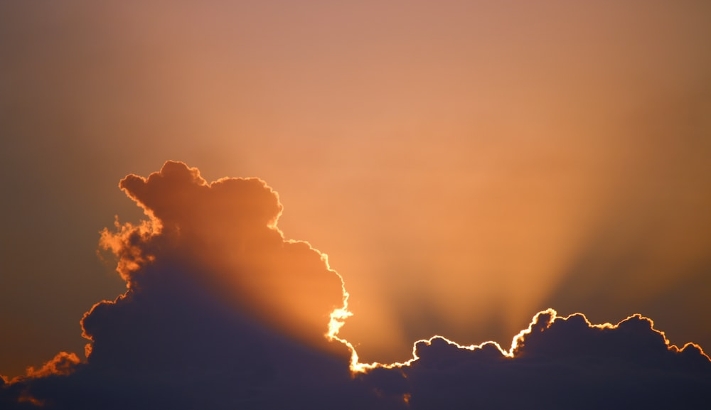 silhouette of cloud with sunlight