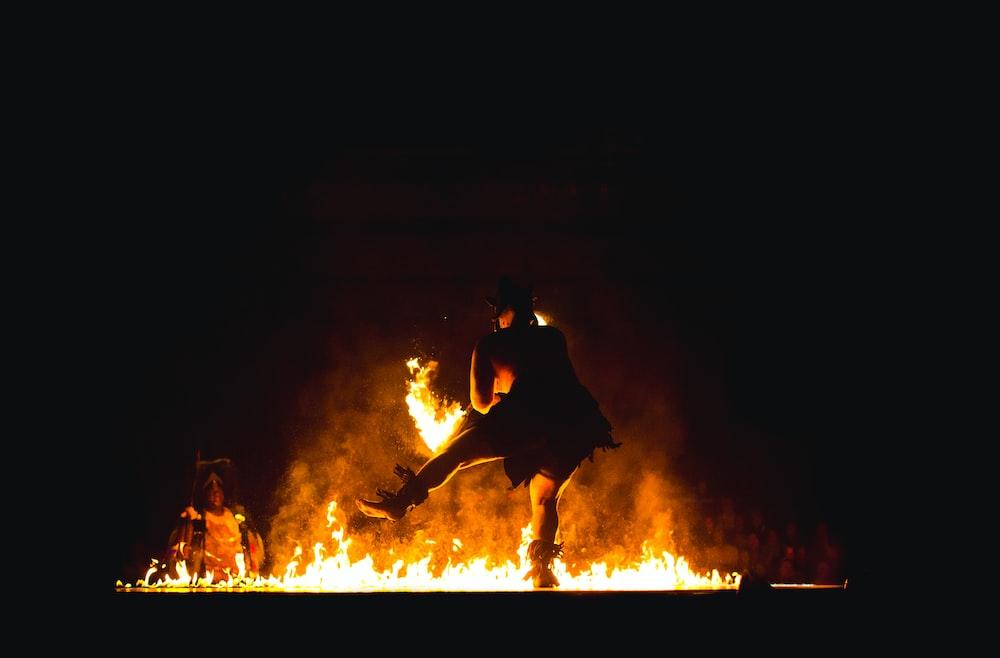 fire dancer near fire pit