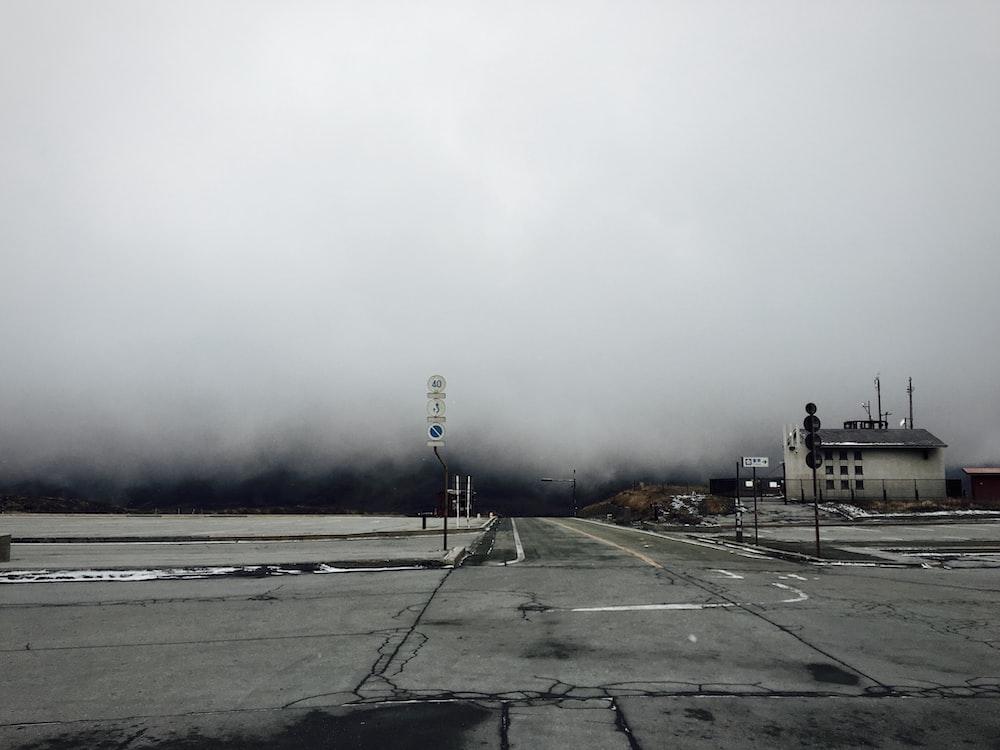 white concrete house under white fog