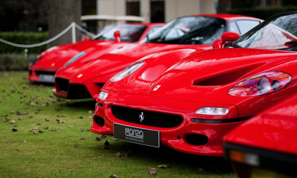 three red Ferrari cards
