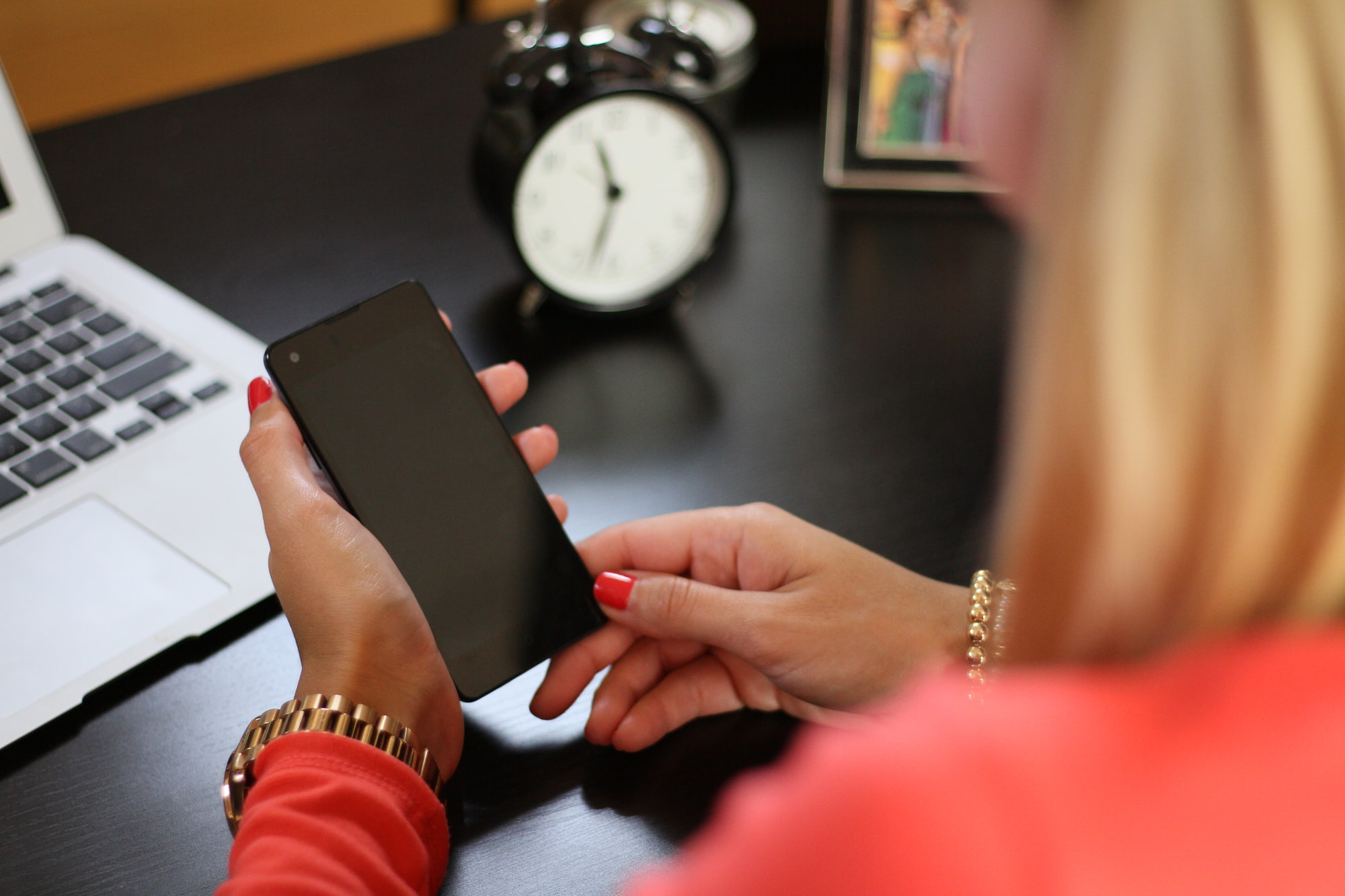 Woman with a phone at a desk
