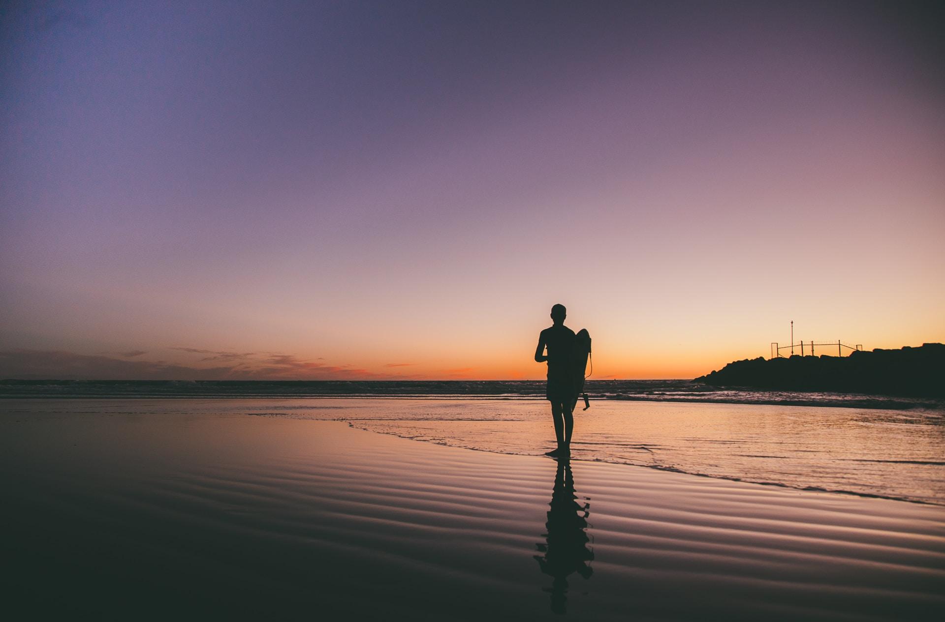 silhouette photo of man near the shore
