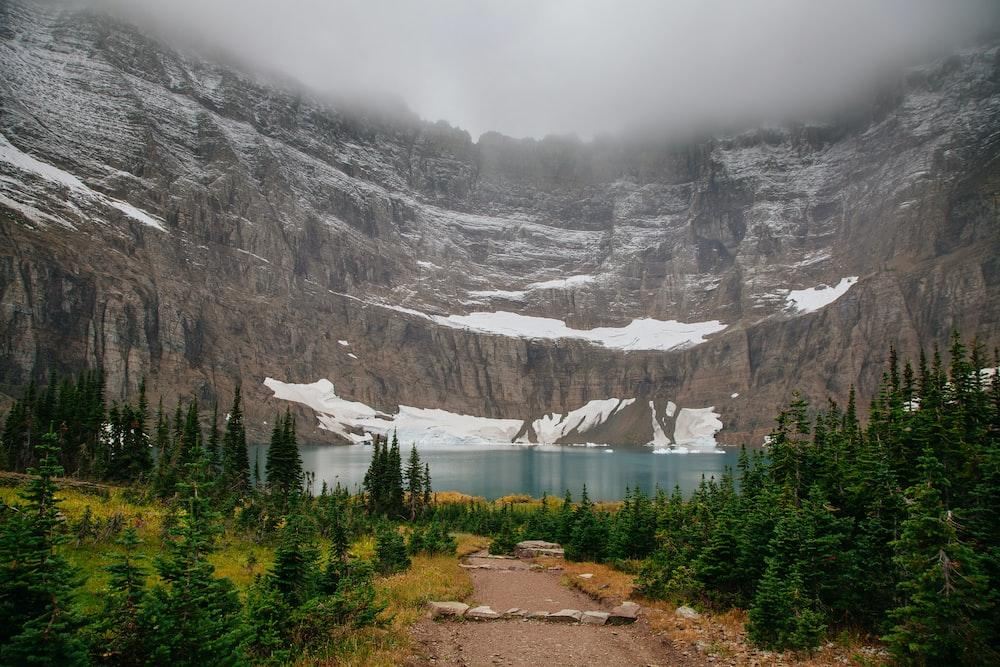 landscape photography of lake near mountain