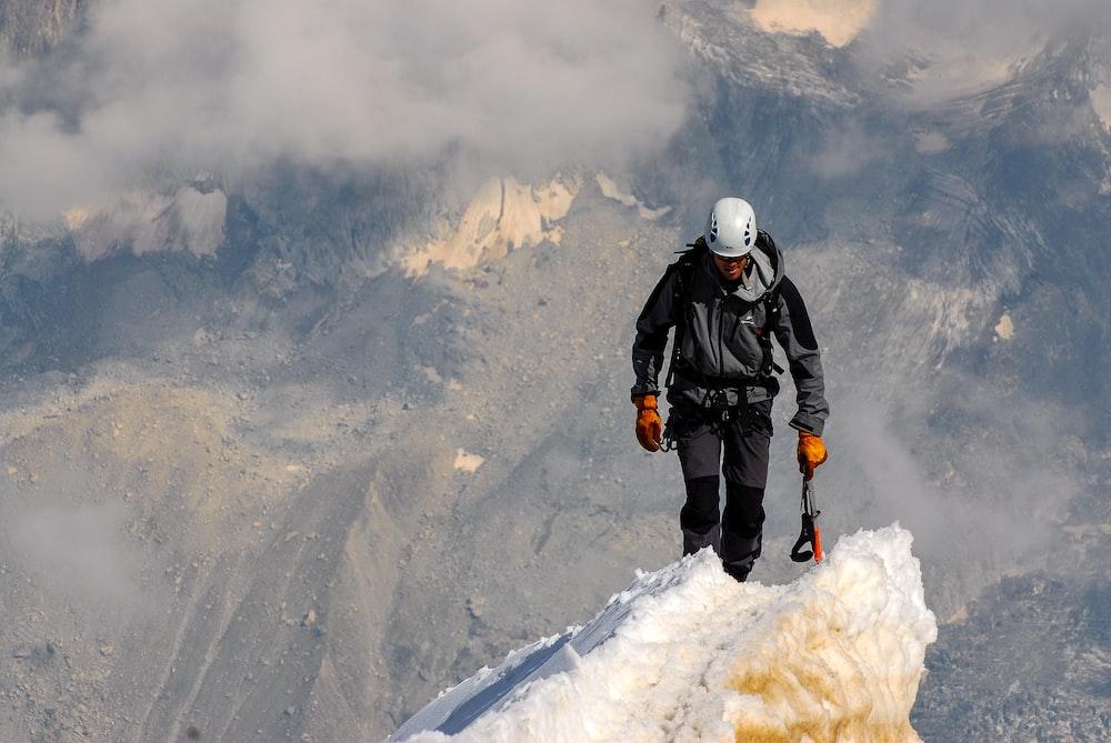 man standing on snow during daytime
