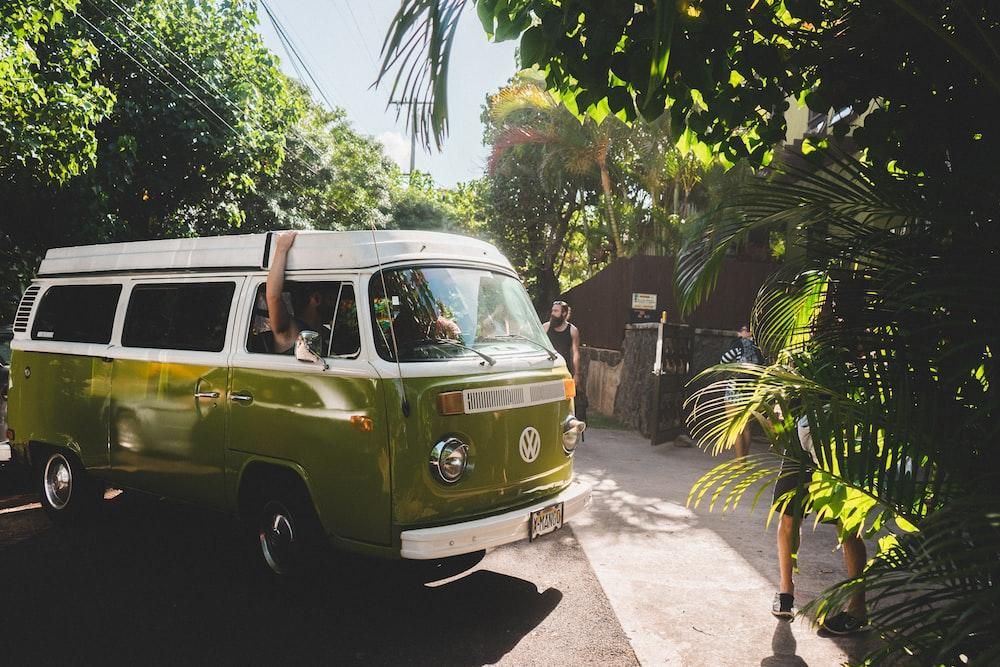 green and white Volkswagen transporter during daytime