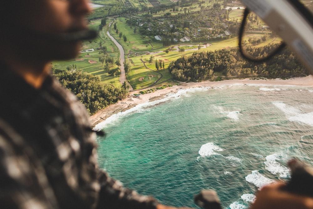 photo of seashore near trees